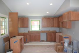 Cabinets getting installed