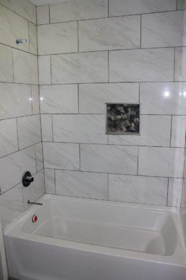 New tub & surround tile