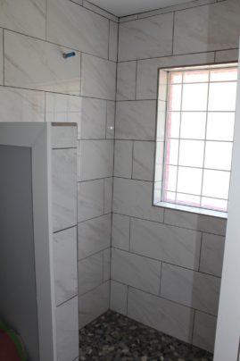Walk-in shower with Glass Block window